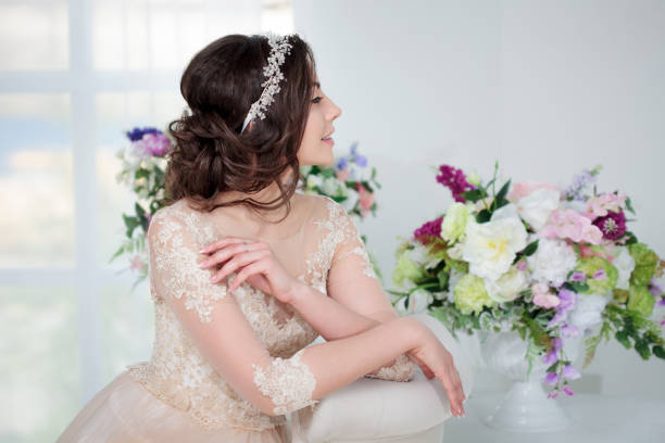 portrait of a beautiful girl in a wedding dress. bride with beautiful decoration in her hair - diadem stock pictures, royalty-free photos & images