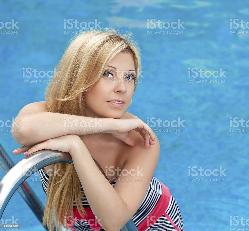 portrait of a beautiful girl in the pool royalty-free stock photo
