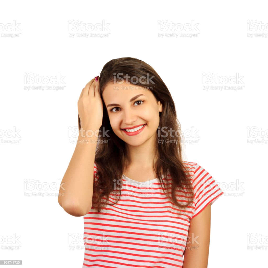 portrait of a beautiful girl who smiles happily and adjusts her hair. emotional girl isolated on white background royalty-free stock photo