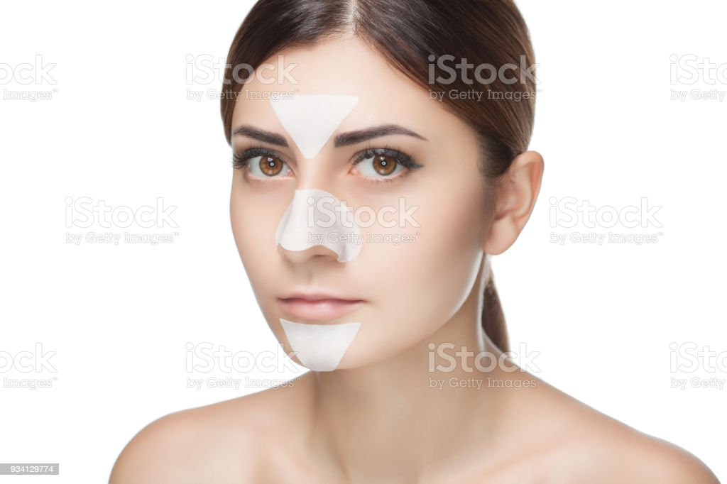 Portrait of a beautiful girl with a mask from acne on the nose stock photo