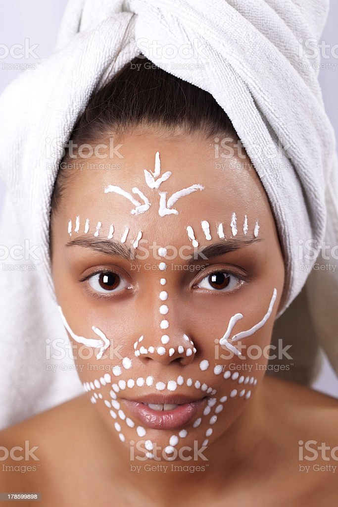 Portrait of a beautiful girl with facial mask stock photo