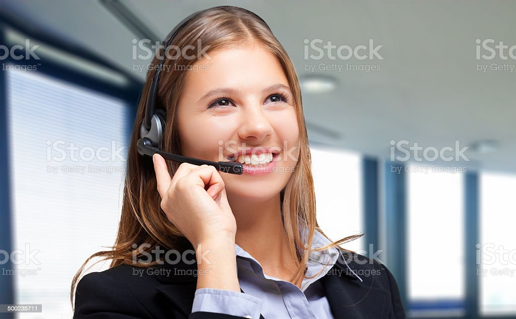 Portrait of a beautiful girl with headset stock photo