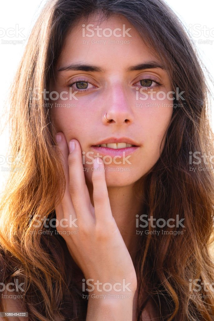 Portrait Of A Beautiful Girl With Long Hair And A Nose Ring Gently