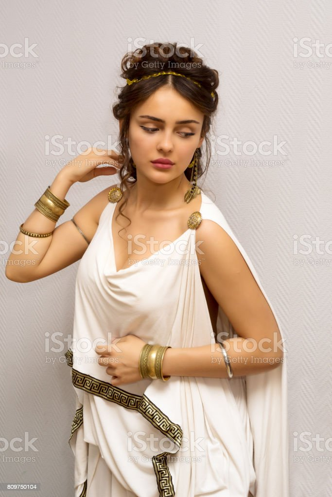 portrait of a beautiful graceful greek young woman in a traditional antique white tunic stock photo