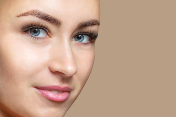Portrait of a beautiful happy smiling woman with clean skin with blue eyes. Professional makeup and cosmetology skin care. stock photo
