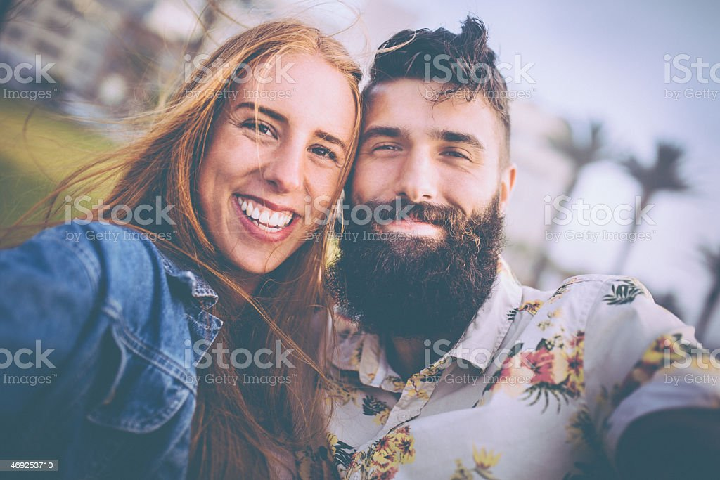 Portrait of a beautiful hipster couple looking happy stock photo