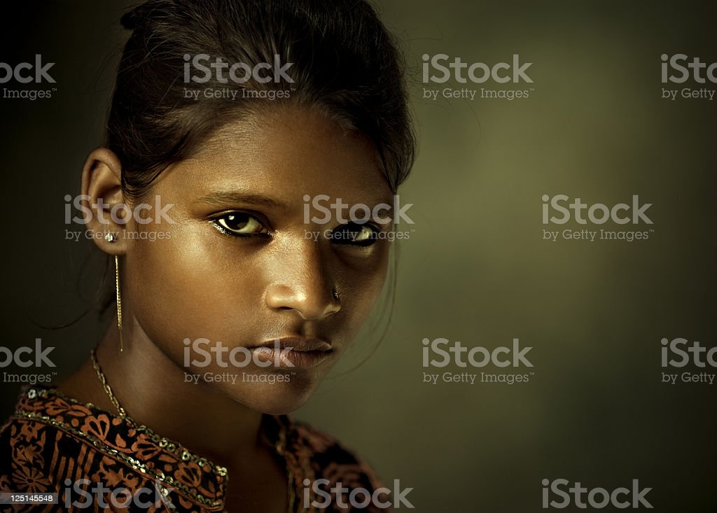 Portrait of a beautiful Indian young woman looking at camera stock photo