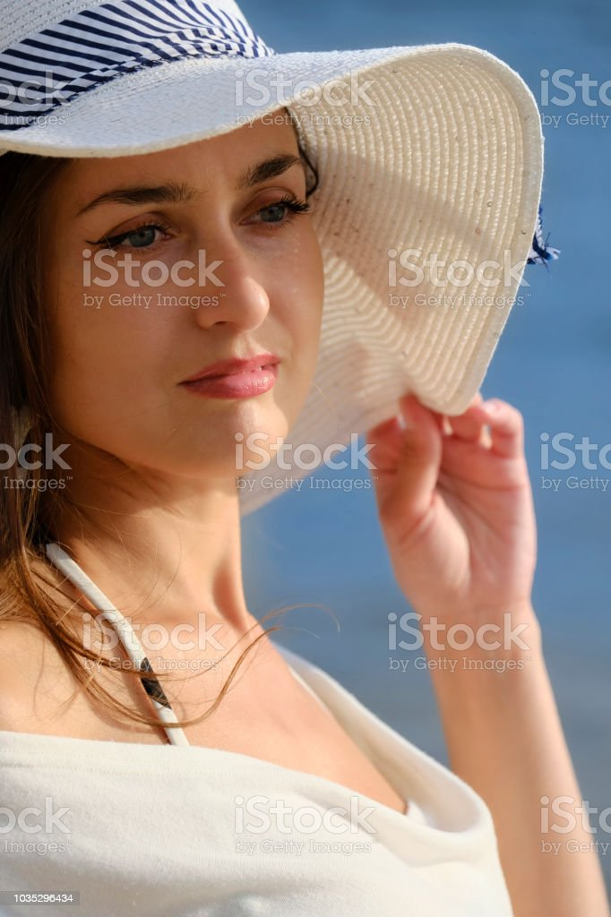 Portrait of a beautiful lady in a hat stock photo