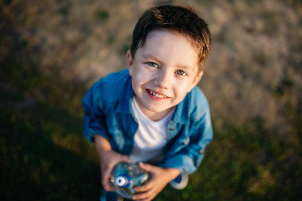 Portrait of a beautiful little boy outdoors stock photo