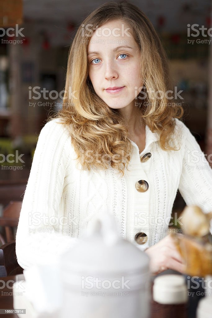 Portrait of a beautiful lonely sad girl in cafe royalty-free stock photo