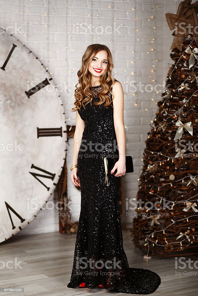 Portrait of a beautiful long-haired young girl in black Evening stock photo