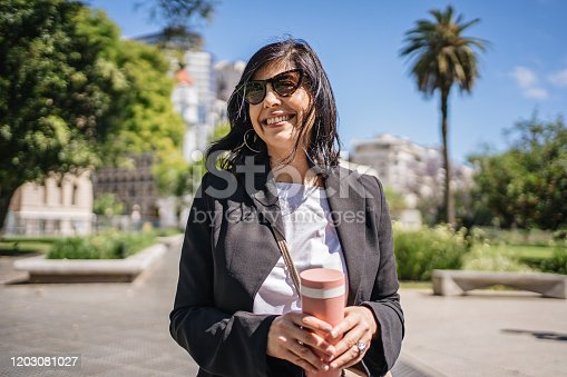 825083304 istock photo Portrait of a beautiful mature businesswoman at a public park after work 1203081027