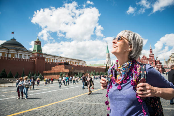Portrait of a Beautiful Mature Woman Enjoying the  Red Square in Moscow, Russia Portrait of a mature woman enjoying the Red Square in Moscow, Russia.  Nikon D800, full frame, XXXL: kremlin stock pictures, royalty-free photos & images