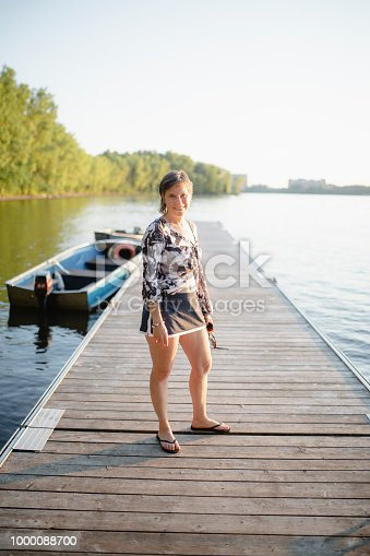 adult, mature woman, river, pier
