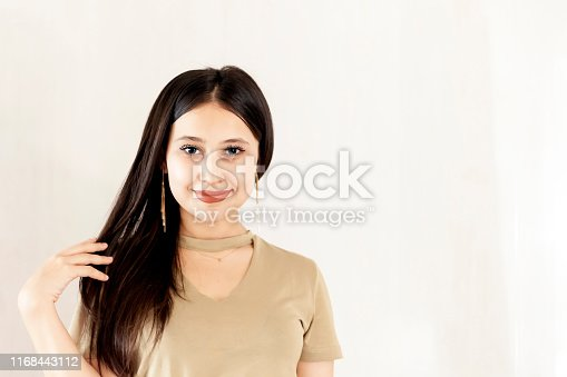 istock Portrait of a beautiful middle-eastern girl. Young attractive female looking into the camera and smiling. 1168443112