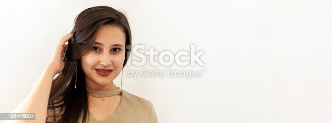 istock Portrait of a beautiful middle-eastern girl. Young attractive female looking into the camera and smiling. 1168445604