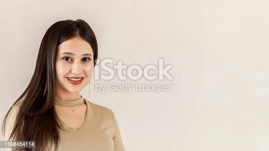 istock Portrait of a beautiful middle-eastern girl. Young attractive female looking into the camera and smiling. 1168454114