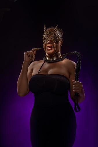 Portrait of a beautiful mixed race dominatrix woman