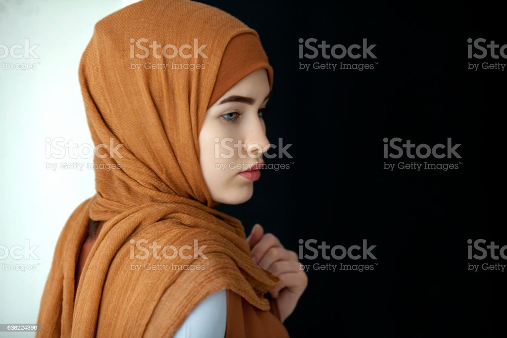Portrait of a beautiful Muslim woman in a green scarf stock photo