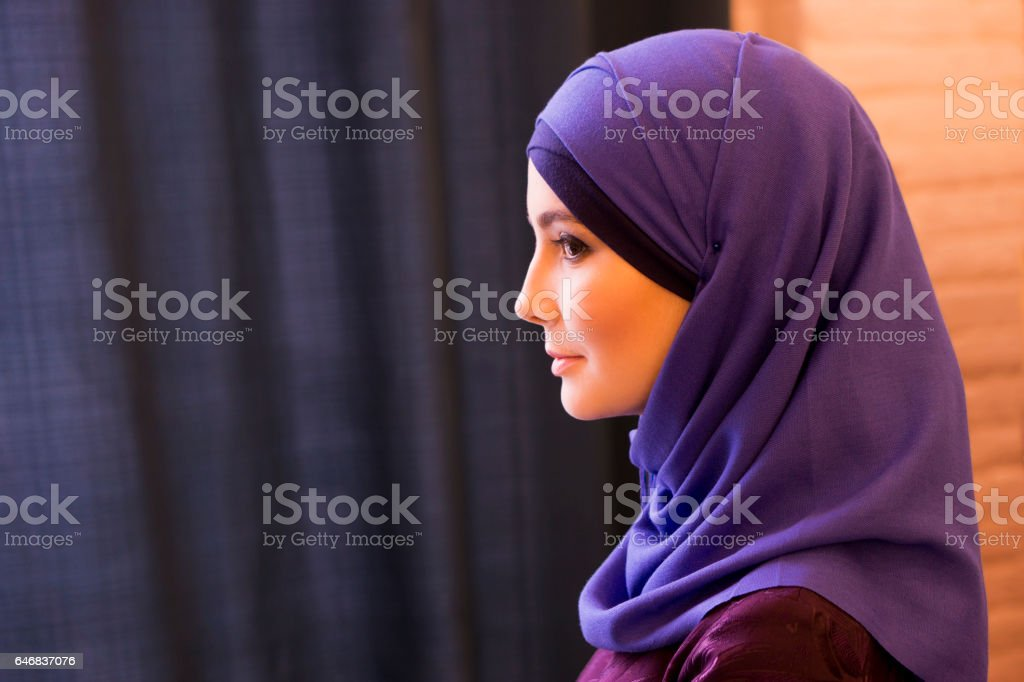 portrait of a beautiful Muslim woman in profile, traditional covered head stock photo
