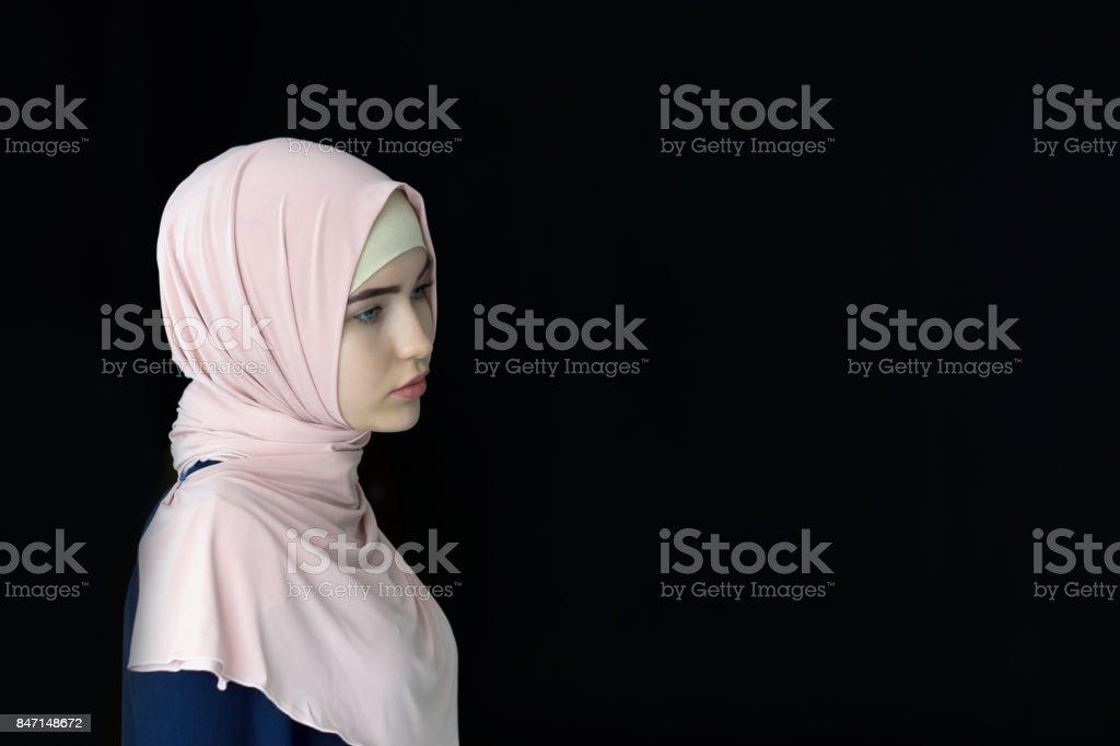 Portrait of a beautiful Muslim woman wearing hijab, isolated stock photo