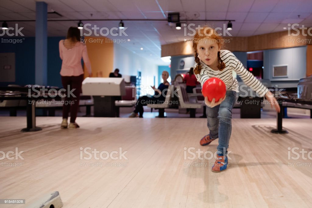 Portrait of a beautiful redhead girl playing Bowling - foto stock