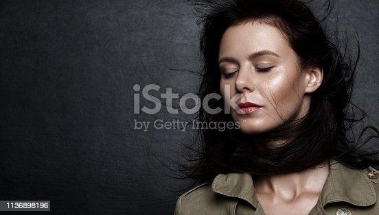 istock Portrait of a beautiful sad girl 1136898196