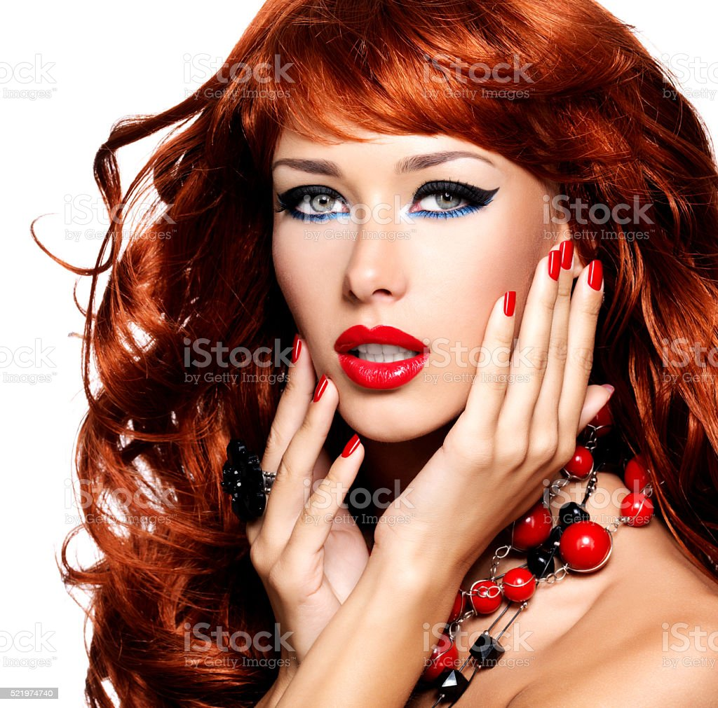 Portrait of a beautiful sensual woman with long red hairs stock photo