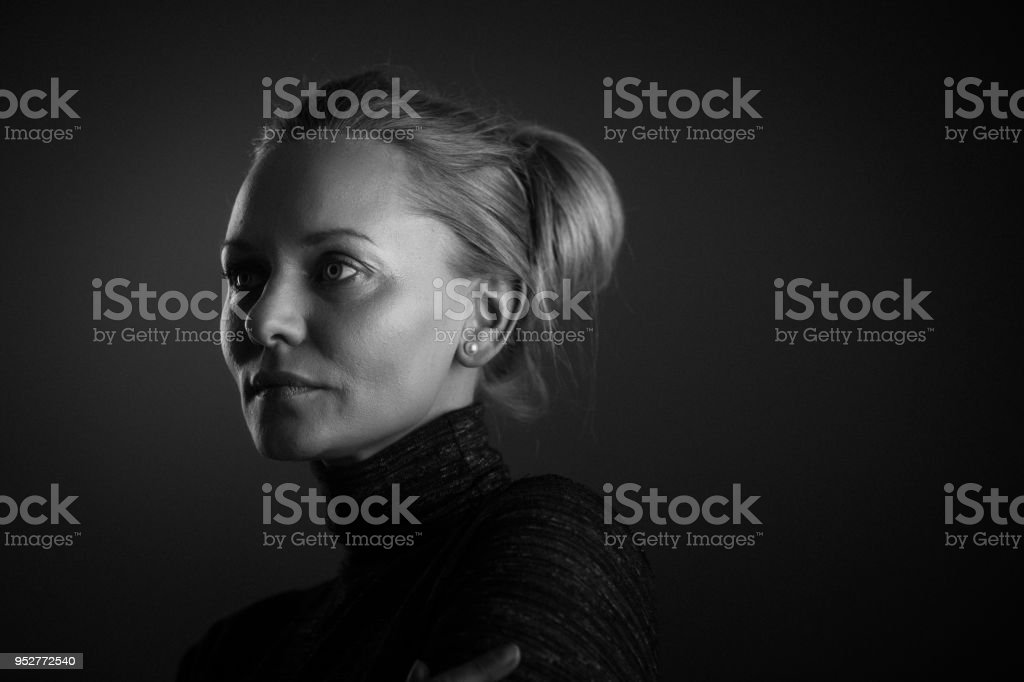 Portrait of a beautiful serious young woman stock photo