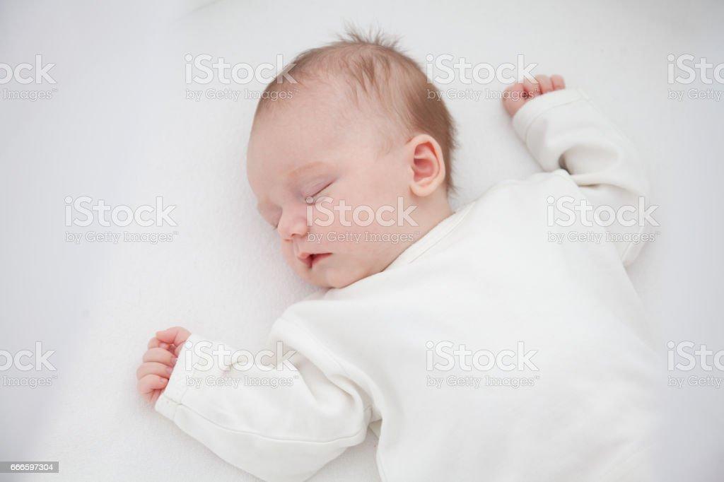 portrait of a beautiful sleeping baby girl stock photo