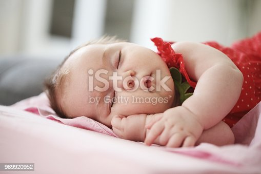 istock Portrait of a beautiful sleeping baby 969920952