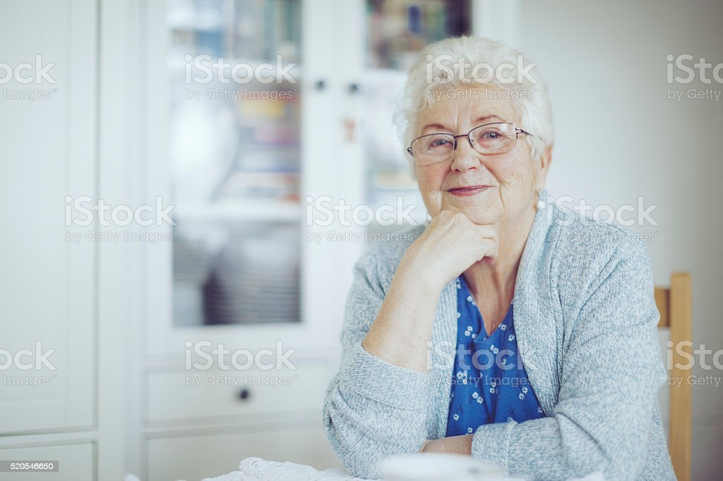 Portrait of a beautiful smiling senior woman stock photo