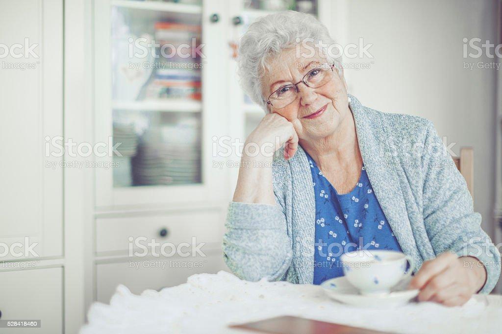 Portrait of a beautiful smiling senior woman stock photo