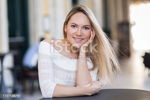 Portrait of beautiful young woman on the defocused lights