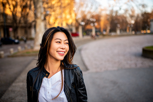 Portrait of a beautiful smiling woman. She is looking away