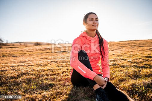 Portrait of a beautiful sporty woman enjoying the view after workout.