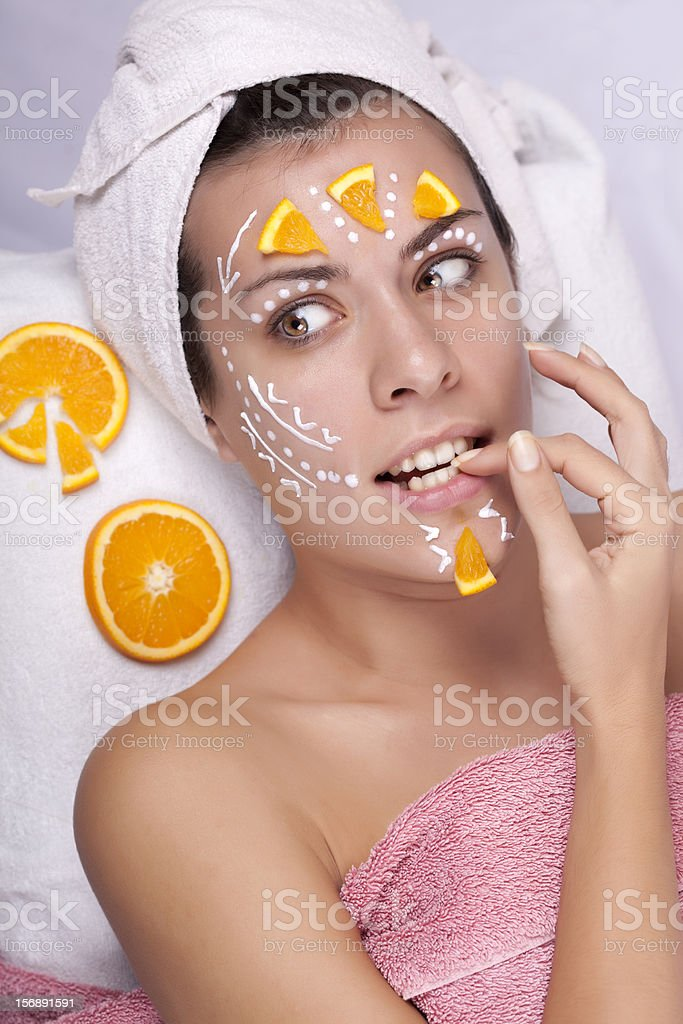 Portrait of a beautiful suprised girl with facial mask stock photo