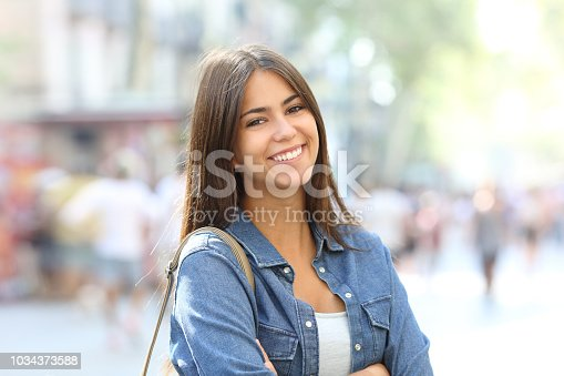 istock Portrait of a beautiful teen with perfect smile 1034373588