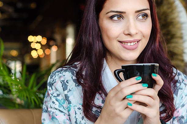 portrait of a beautiful teenage girl with coffee - foto de acervo