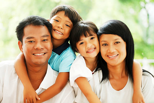 Portrait of a beautiful Thai family. Close-up of a beautiful Asian family looking at the camera.    vietnamese ethnicity stock pictures, royalty-free photos & images
