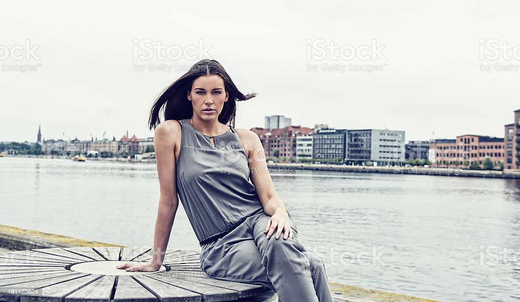 Portrait of a beautiful woman at harbor stock photo