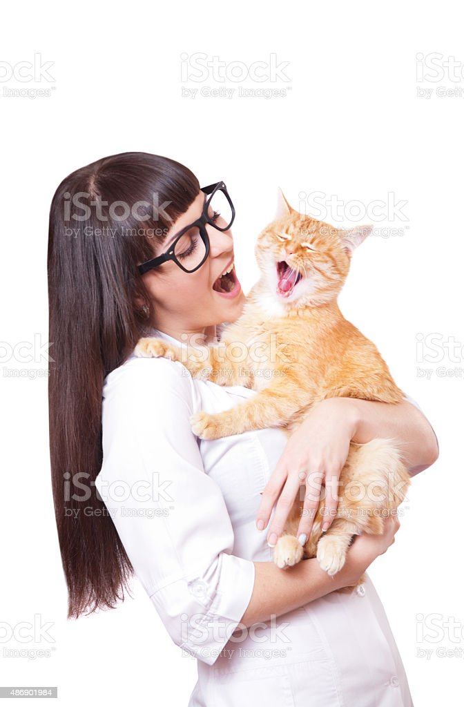 Portrait of a beautiful woman holding red cat stock photo