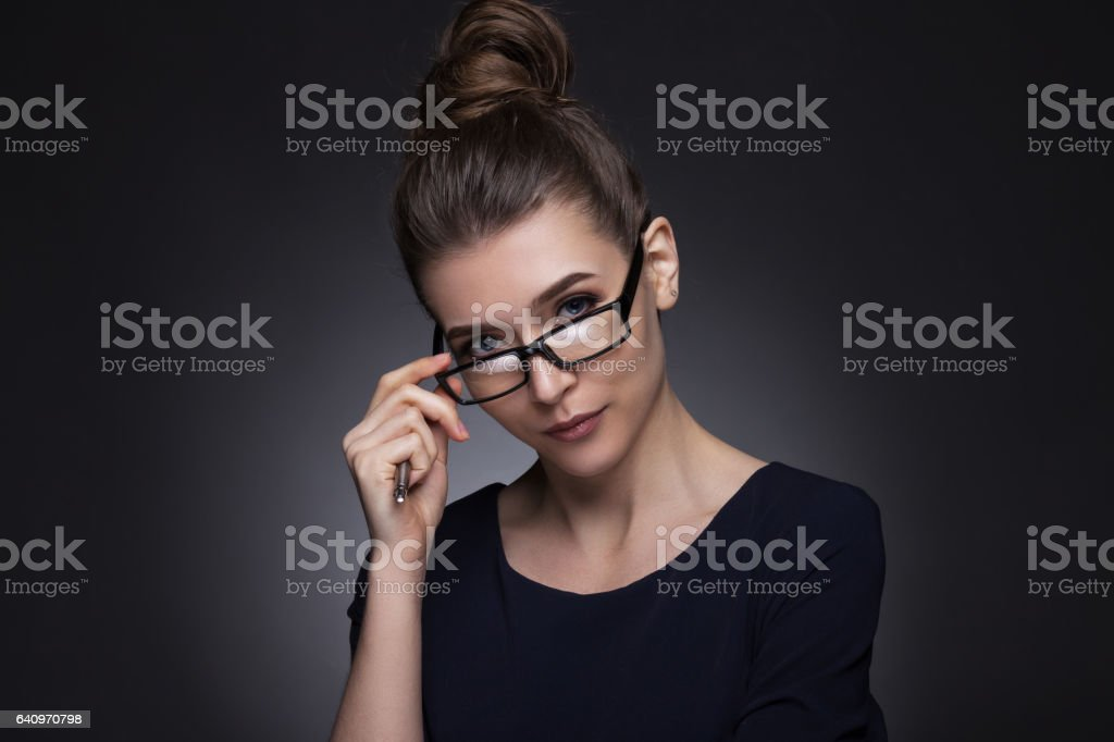 Portrait of a beautiful woman in a business style. stock photo