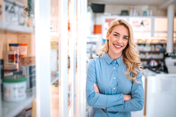 Portrait of a beautiful woman in a drugstore. stock photo