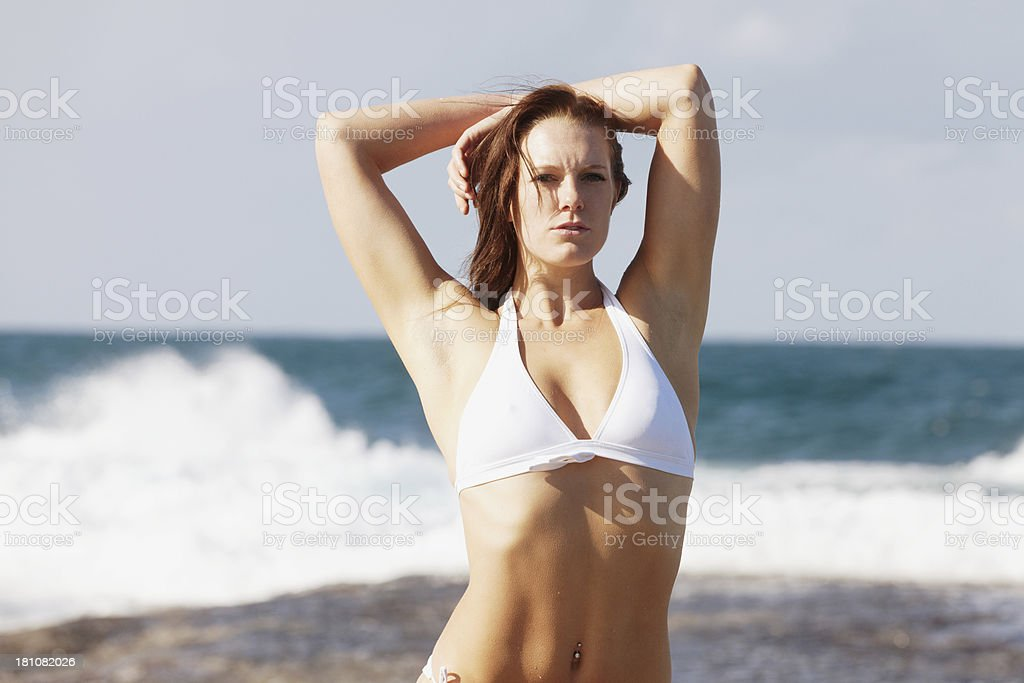 Portrait of a beautiful woman in bikini posing royalty-free stock photo