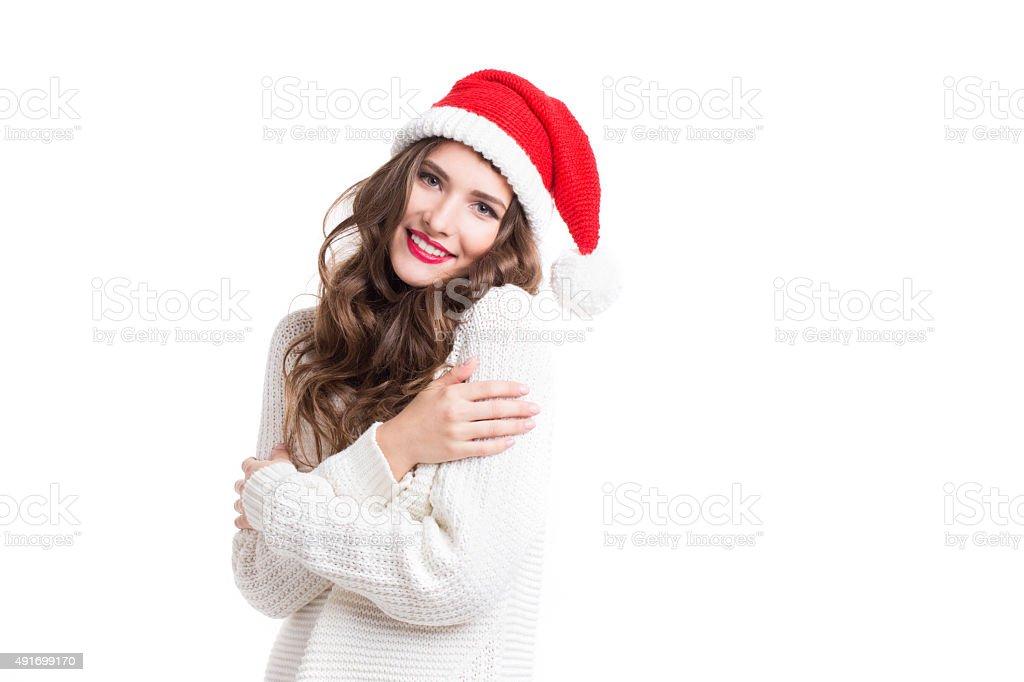 Portrait of a beautiful woman in santa hat. stock photo