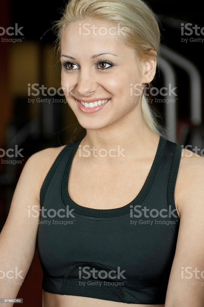 Portrait of a beautiful woman in the fitness club royalty-free stock photo