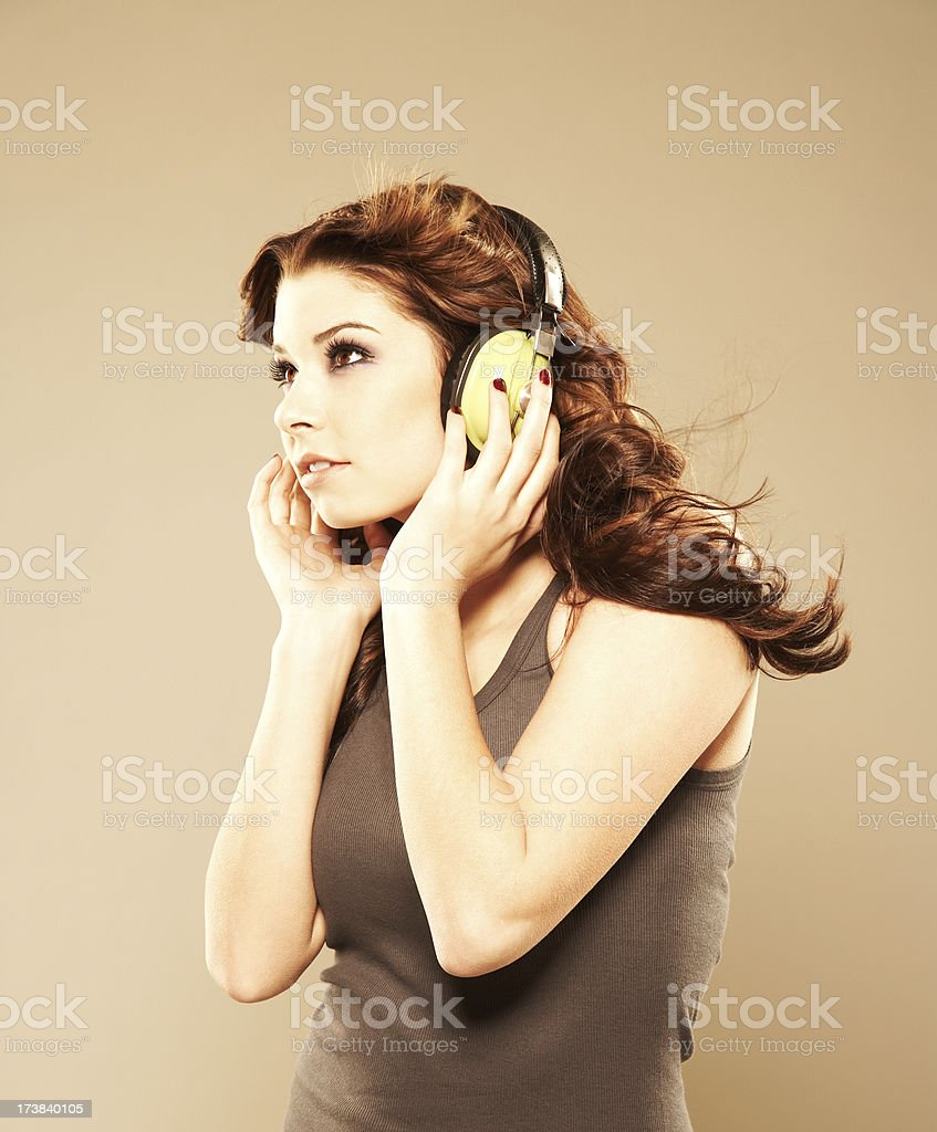 Portrait of a beautiful woman listening to music royalty-free stock photo
