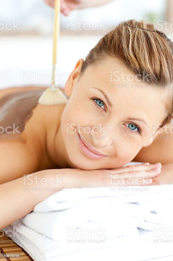 Portrait of a beautiful woman receiving beauty treatment with mud royalty-free stock photo
