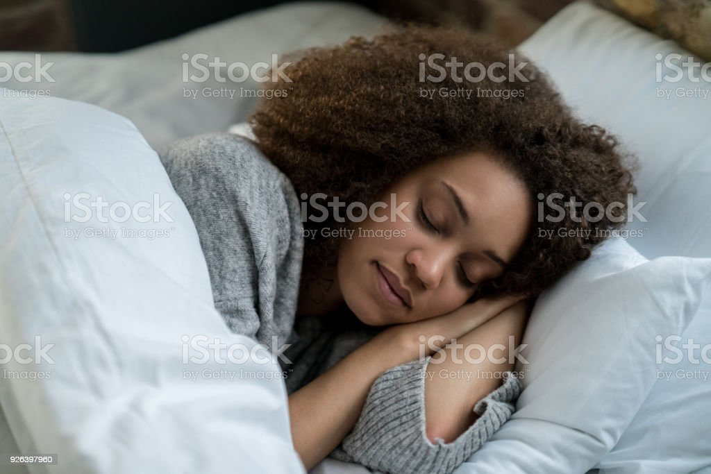 Portrait of a beautiful woman sleeping stock photo